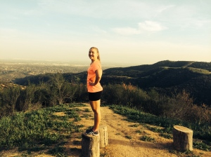 Me standing at the top of one of my favorite running trails